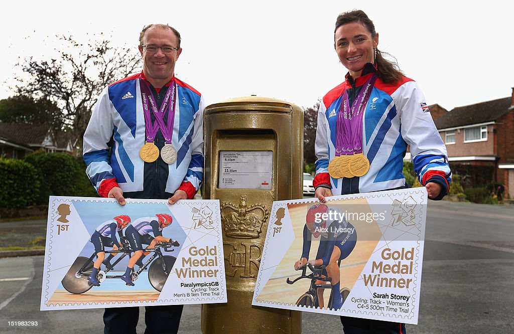 Sarah and <a gi-track='captionPersonalityLinkClicked' href=/galleries/search?phrase=Barney+Storey&family=editorial&specificpeople=650752 ng-click='$event.stopPropagation()'>Barney Storey</a> pose with their Paralympic medals and stamp artwork next to a Royal Mail post box painted in honour of their Paralympic gold medals in the village of Poynton on September 14, 2012 in Stockport, England. <a gi-track='captionPersonalityLinkClicked' href=/galleries/search?phrase=Sarah+Storey&family=editorial&specificpeople=5521640 ng-click='$event.stopPropagation()'>Sarah Storey</a> was a student at Poynton High School where the gold post box is situated.