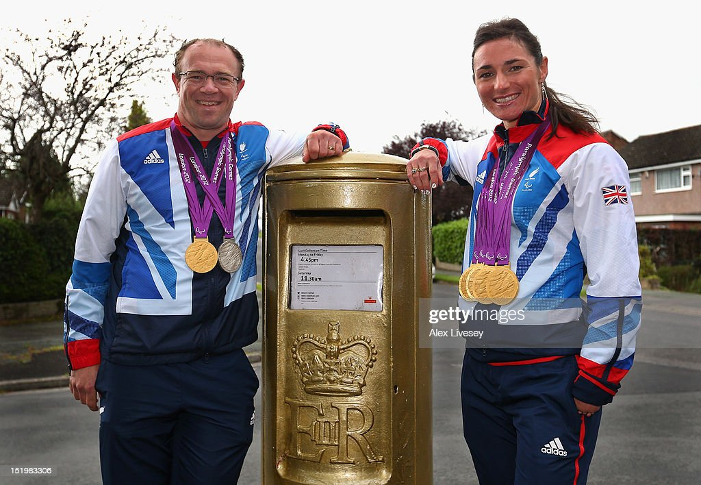 Sarah and <a gi-track='captionPersonalityLinkClicked' href=/galleries/search?phrase=Barney+Storey&family=editorial&specificpeople=650752 ng-click='$event.stopPropagation()'>Barney Storey</a> pose with their Paralympic medals next to a Royal Mail post box painted in honour of their Paralympic gold medals in the village of Poynton on September 14, 2012 in Stockport, England. <a gi-track='captionPersonalityLinkClicked' href=/galleries/search?phrase=Sarah+Storey&family=editorial&specificpeople=5521640 ng-click='$event.stopPropagation()'>Sarah Storey</a> was a student at Poynton High School where the gold post box is situated.
