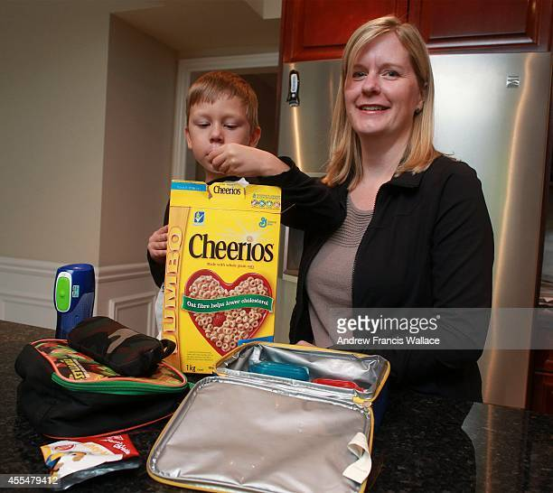 Sarah and her son Luke at their Aurora home September 12 2014 One Hamilton school is blocking milk hardboiled eggs and tuna salad sandwiches from...