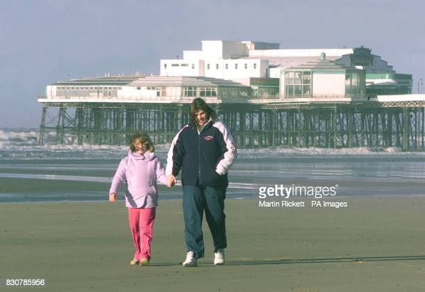 Sarah and Kelly Mack from London brave the wind on the beach in Blackpool Lancashire as severe gales sweep northern England * Elsewhere thousands of...