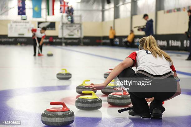 Sarah Anderson of USA looks on as her partner Korey Dropkin walks his stone to her in the Curling Mixed Doubles Semi Finals during the Winter Games...