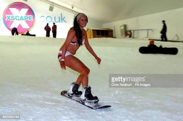 Sarah Angelinetta from Milton Keynes takes a break from the heat as she snowboards down the slopes at the Xscape Snowdome in Milton Keynes