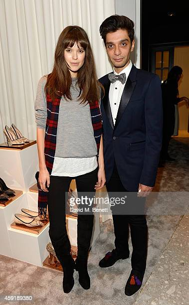 Sarah Ann Macklin and Crisian Monagas attends the Crisian London Dover Street Boutique Opening on November 18 2014 in London England