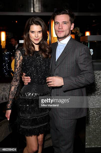 Sarah Ann Macklin and guest attend the Omega Oxford Street Store Opening Party at The Shard on December 10 2014 in London England