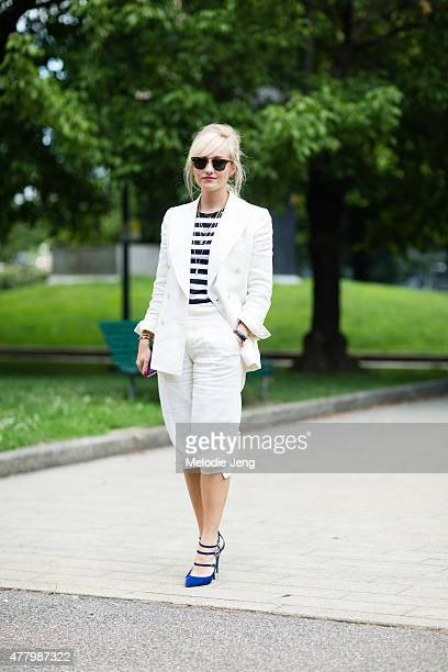 Sarah Ann Murray of The Rake wears a bespoke Rubinacci suit and Nicholas Kirkwood heels during Milan Men's Fashion Week Spring/Summer 2016 on June 20...