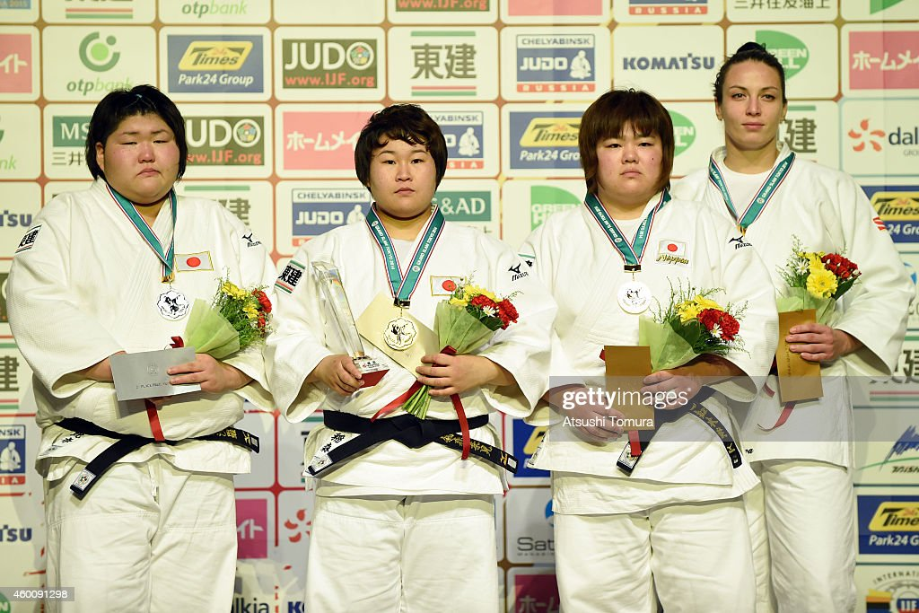 Sarah Asahina of Japan (Silver), Nami Inamori of Japan (Gold), <a gi-track='captionPersonalityLinkClicked' href=/galleries/search?phrase=Megumi+Tachimoto&family=editorial&specificpeople=5645971 ng-click='$event.stopPropagation()'>Megumi Tachimoto</a> of Japan (Bronze) and Ksenia Chibisova of Russia (Bronze) pose in the victory ceremony for Women's +78kg during Judo Grand Slam Tokyo 2014 at Tokyo Metropolitan Gymnasium on December 7, 2014 in Tokyo, Japan.