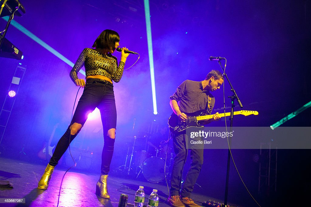 Sarah Barthel and Josh Carter of Phantogram perform on stage at Terminal 5 on December 4 2013 in New York New York