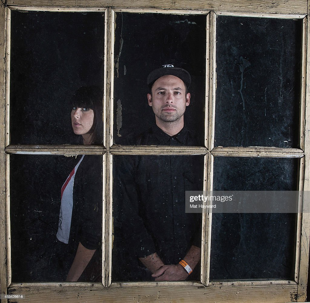 Sarah Barthell and Josh Carter of Phantogram pose for a photo backstage during Summer Camp hosted by 1077 The End at Marymoor Park on August 9 2014...