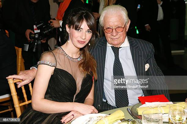 Sarah Barzyk and Photographer David Hamilton attend the Sidaction Gala Dinner 2014 at Pavillon d'Armenonville on January 23 2014 in Paris France