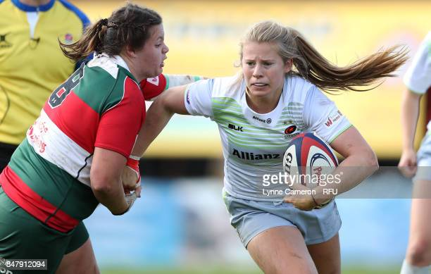 Sarah Beckett of Firwood Waterloo Ladies holds back Zoe Harrison of Saracens Women during the Tyrrells Premier 15 at The Memorial Ground on September...