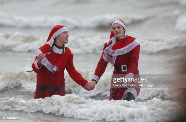 Sarah Bennett aged 14 and Felicity Owen 18 taking part in the 39th Porthcawl Christmas day swim The event which raises money through sponsored...