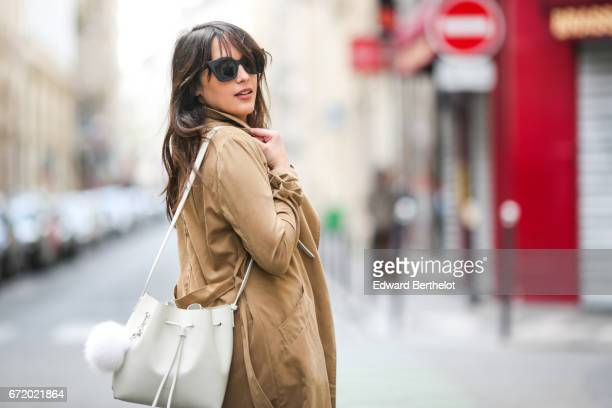 Sarah Benziane fahsion blogger Les Colonnes de Sarah wears a New Look white top a New Look brown trench coat New Look blue denim jeans a Lancaster...