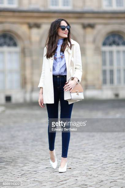 Sarah Benziane fashion blogger from Les Colonnes de Sarah wears a Sandro white coat an Aliexpress blue top with floral print Primark jeans a...
