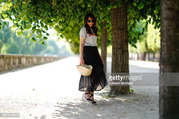 Sarah Benziane fashion blogger Les Colonnes de Sarah wears a The Kooples ruffled black skirt a New Look tshirt with the printed inscription 'New...