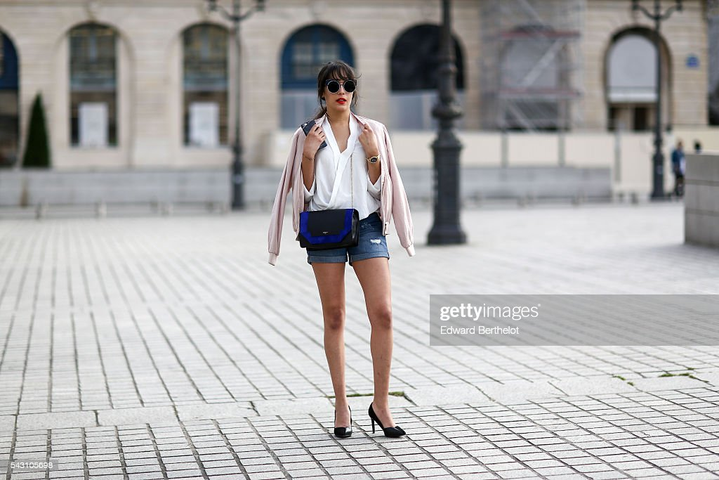 Sarah Benziane is wearing a New look jacket, a Bershka short, Charles & Keith shoes, a Minelli bag, and L'Usine a Lunettes by Polette sunglasses, after the Henrik Vibskov show, during Paris Fashion Week Menswear Spring/summer 2017, on June 25, 2016 in Paris, France.