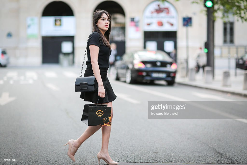 Sarah Benziane (fashion blogger @lescolonnesdesarah - Les colonnes de Sarah), is wearing a Zara black skirt, a Zara black top, a Mango black bag, and Just Fab heels, during a street style session, on April 28, 2016 in Paris, France.