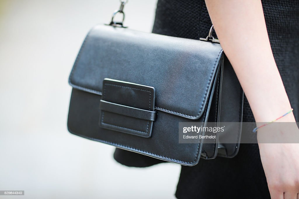 Sarah Benziane (fashion blogger @lescolonnesdesarah - Les colonnes de Sarah), is wearing a Zara black skirt, a Zara black top, a Mango black bag, and Just Fab heels, during a street style session, on April 28, 2016 in Paris, France.