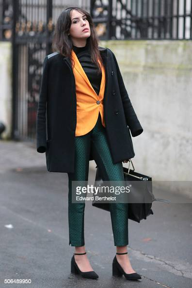 Sarah Benziane wearing a Maje coat a Zara suit and a Zara bag before the Balmain show during Paris Fashion Week Menswear Fall Winter 2016/2017 on...
