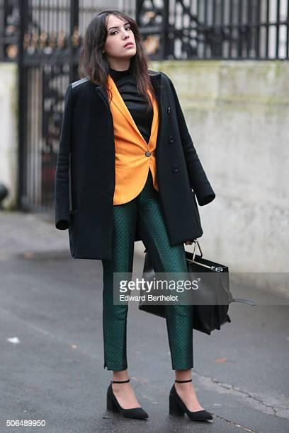 Sarah Benziane wearing a Maje coat a Zara suit and a Zara bag before the Balmain show during Paris Fashion Week Menswear Fall Winter 2016/2017 on...