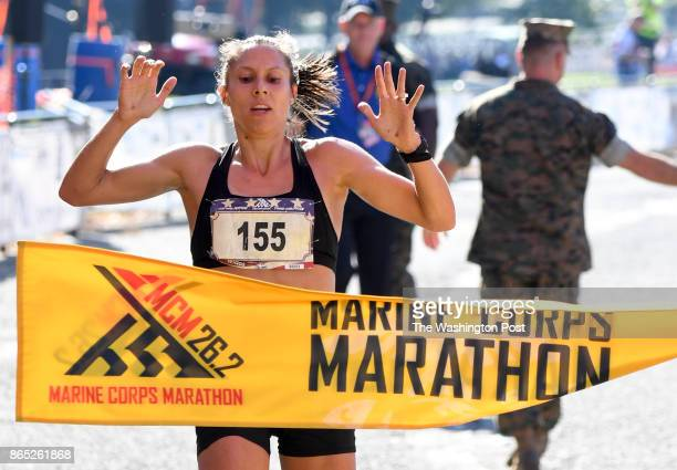 Sarah Bishop of Fairfax wins the Women's division with a time of 24507 during the 42nd running of the Marine Corps Marathon