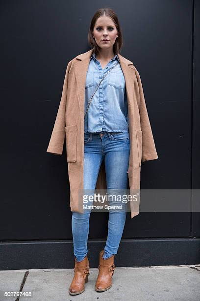 Sarah Blank is seen on Michigan Avenue wearing a camel Forever 21 coat light blue denim HM shirt blue denim HM jeans light brown leather Francesca's...
