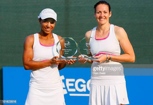 Sarah Borwell of Great Britain and Raquel KopsJones of the United States pose with the trophies after winning the women's doubles final match between...