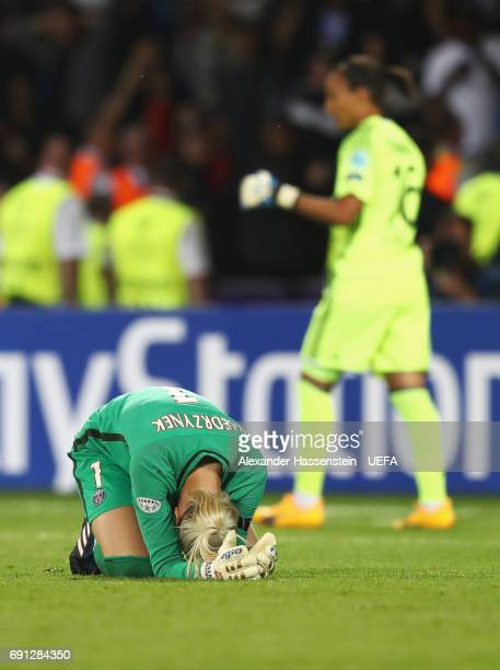 Sarah Bouhaddi of Olympique Lyonnais celebrates as Katarzyna Kiedrzynek of Paris SaintGermain Feminines reacts as she misses a penalty in the shoot...