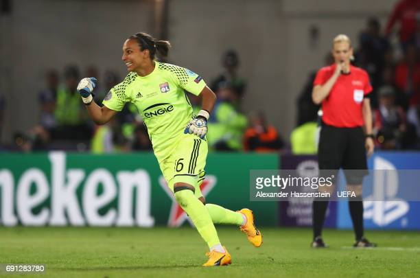 Sarah Bouhaddi of Olympique Lyonnais celebrates victory as she scores the winning penalty in the shoot out during the UEFA Women's Champions League...