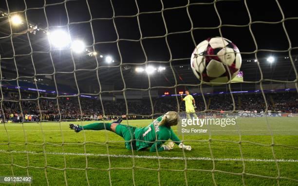 Sarah Bouhaddi of Olympique Lyonnais scores the winning penalty in the shoot out past goalkeeper Katarzyna Kiedrzynek of Paris SaintGermain Feminines...