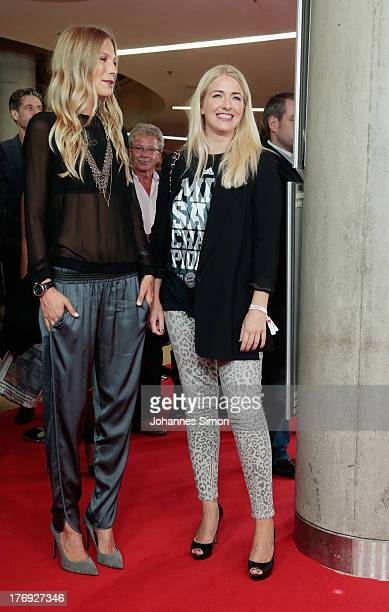 Sarah Brandner girl friend of German football player Bastian Schweinsteiger and Claudia Lahm chat together ahead of the Wembley Football Is Coming...