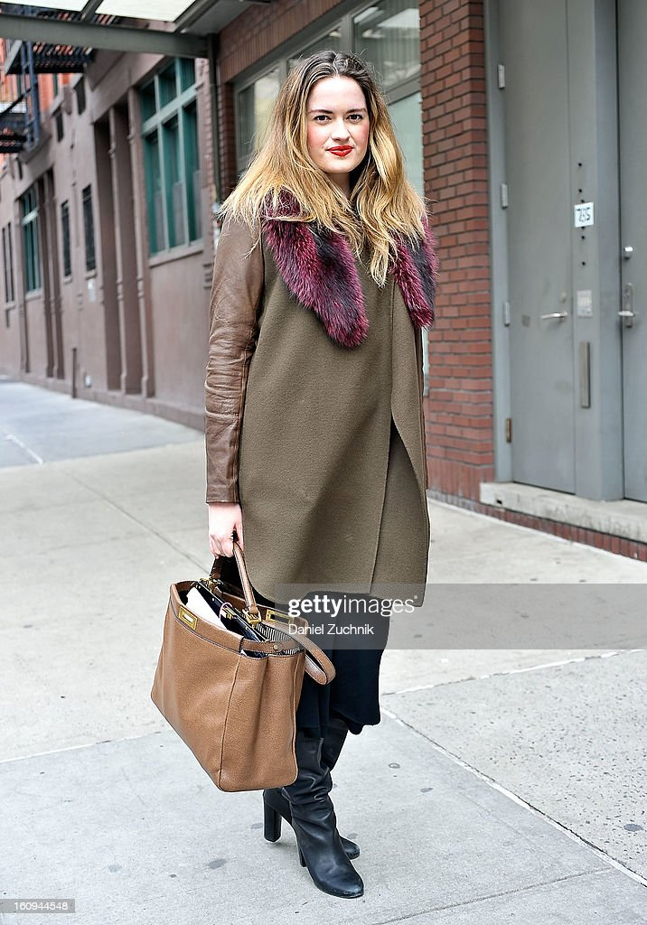 Sarah Bray, social Media for Neiman Marcus, seen outside the Duckie Brown show wearing a Tibi dress, Vince jacket, Neiman Marcus fur shawl and a Fendi peekaboo handbag on February 7, 2013 in New York City.