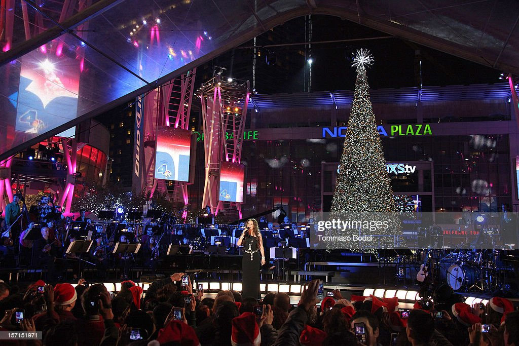 <a gi-track='captionPersonalityLinkClicked' href=/galleries/search?phrase=Sarah+Brightman&family=editorial&specificpeople=208636 ng-click='$event.stopPropagation()'>Sarah Brightman</a> performs at the 5th annual Holiday Tree Lighting at L.A. LIVE & opening of LA Kings Holiday Ice held at Nokia Plaza L.A. LIVE on November 28, 2012 in Los Angeles, California.