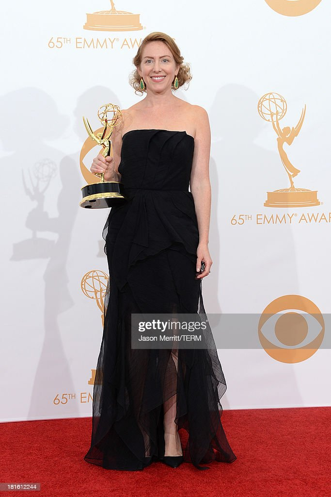 Sarah Bromell who accepted on behalf of her husband Writer Henry Bromell winner of the Best Writing for a Drama Series Award for 'Homeland' poses in...