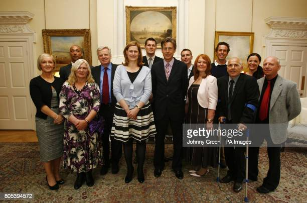 Sarah Brown the secretary of state for culture media and sport Ben Bradshaw and the executive chairman of ITV Michael Grade pose for a portrait with...