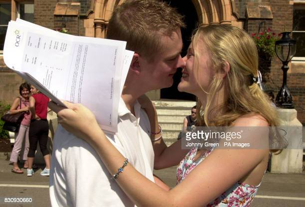 Sarah Bull is congratulated by her boyfriend Ian Dempsey after opening her ASLevel exam results to find two 'A's' and two 'B's' inside St Dunstan's...