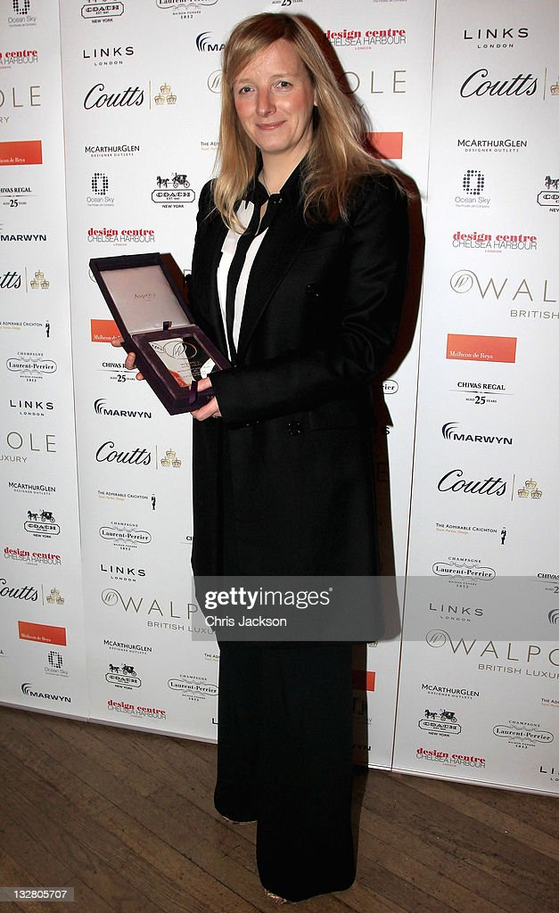 Sarah Burton of Alexander McQueen poses with the British Luxury Design Talent Awrad at the Walpole Awards of Excellence 2011 at Banqueting House on November 14, 2011 in London, England.