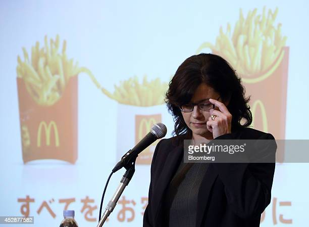 Sarah Casanova chief executive officer of McDonald's Holdings Co Japan Ltd adjusts her glasses during a news conference in Tokyo Japan on Tuesday...