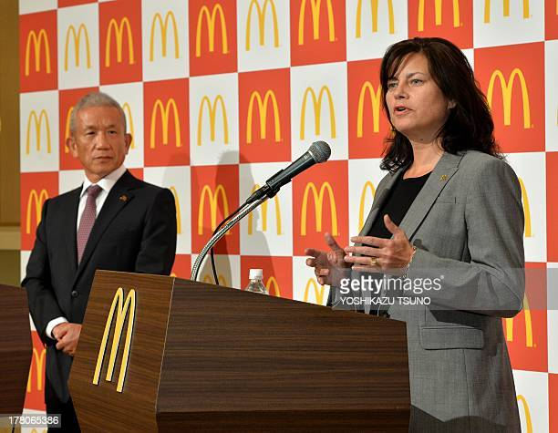 Sarah Casanova speaks after she was named McDonald's Japan new president while chairman Eiko Harada looks on at a press conference in Tokyo on August...