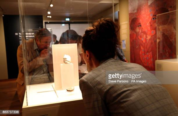 Sarah Casey Digital Communications manager for the Ashmolean Museum looks at a Nose and mouth from a statue of King Akhenaten made from Indurated...