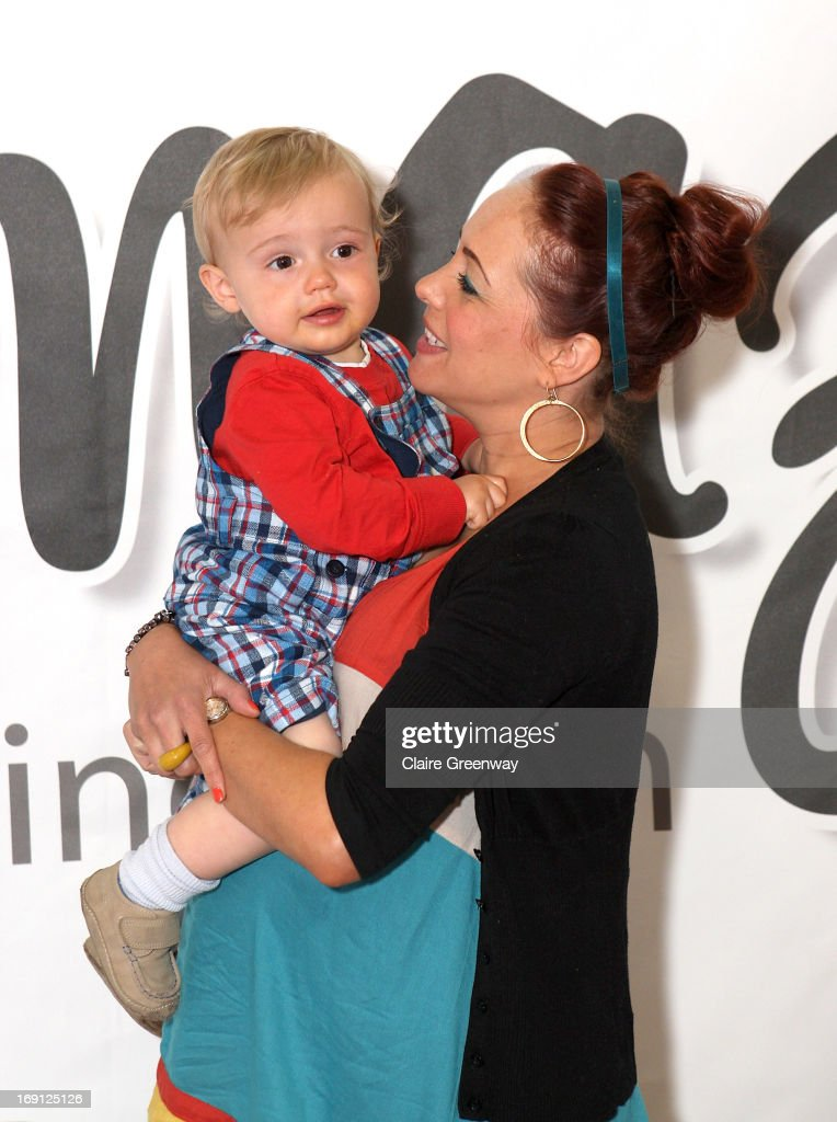<a gi-track='captionPersonalityLinkClicked' href=/galleries/search?phrase=Sarah+Cawood&family=editorial&specificpeople=208750 ng-click='$event.stopPropagation()'>Sarah Cawood</a> and son Hunter attend a photocall to celebrate fellow contributor Denise van Outen joining 'Mumazine' magazine at Alexandra Palace on May 18, 2013 in London, England. Mumazine is an online magazine with features by and about celebrity mums and offering parenting, fashion and nutrition advice.