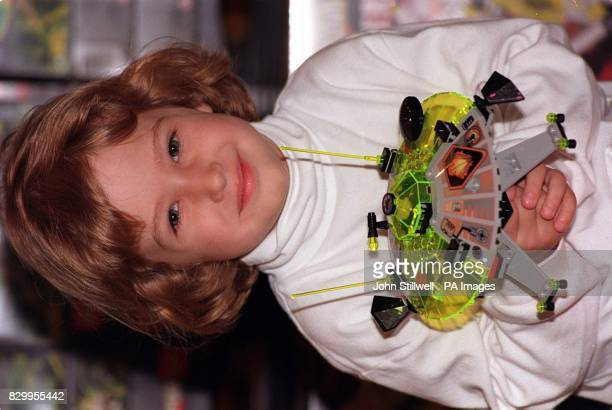 Sarah Cohen aged four from Columbus Ohio holds one of the new Lego UFOs that were unveiled at Hamleys in London today The new range of UFOs are being...