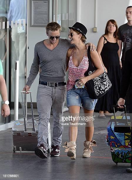 Sarah Connor and Florian Fischer leave Vienna at Airport Vienna on September 5 2012 in Vienna Austria