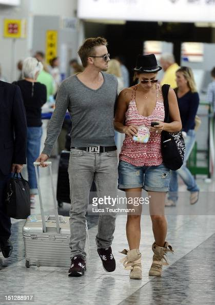Sarah Connor and Florian Fischer leave Vienna at Airport Vienna on September 5 2012 in Vienna Austria