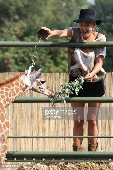Sarah Connor christens a baby giraffe named Kerstin at Serengeti Park on August 15 2013 in Hodenhagen Germany