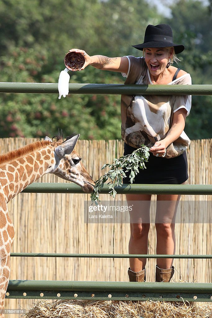 <a gi-track='captionPersonalityLinkClicked' href=/galleries/search?phrase=Sarah+Connor&family=editorial&specificpeople=220670 ng-click='$event.stopPropagation()'>Sarah Connor</a> christens a baby giraffe named Kerstin at Serengeti Park on August 15, 2013 in Hodenhagen, Germany.