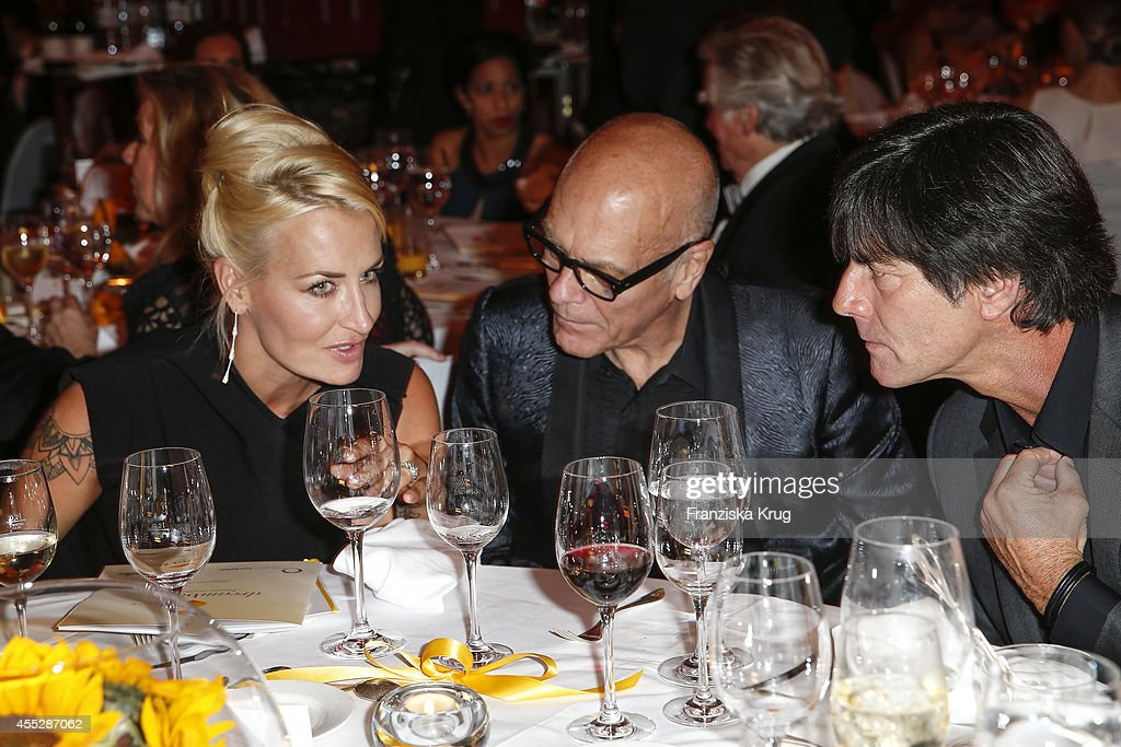 Sarah Connor Joachim Loew and guest attend the Dreamball 2014 at the Ritz Carlton on September 11 2014 in Berlin Germany