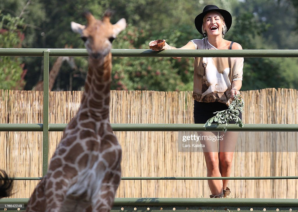 <a gi-track='captionPersonalityLinkClicked' href=/galleries/search?phrase=Sarah+Connor&family=editorial&specificpeople=220670 ng-click='$event.stopPropagation()'>Sarah Connor</a> laughs at Serengeti Park on August 15, 2013 in Hodenhagen, Germany.