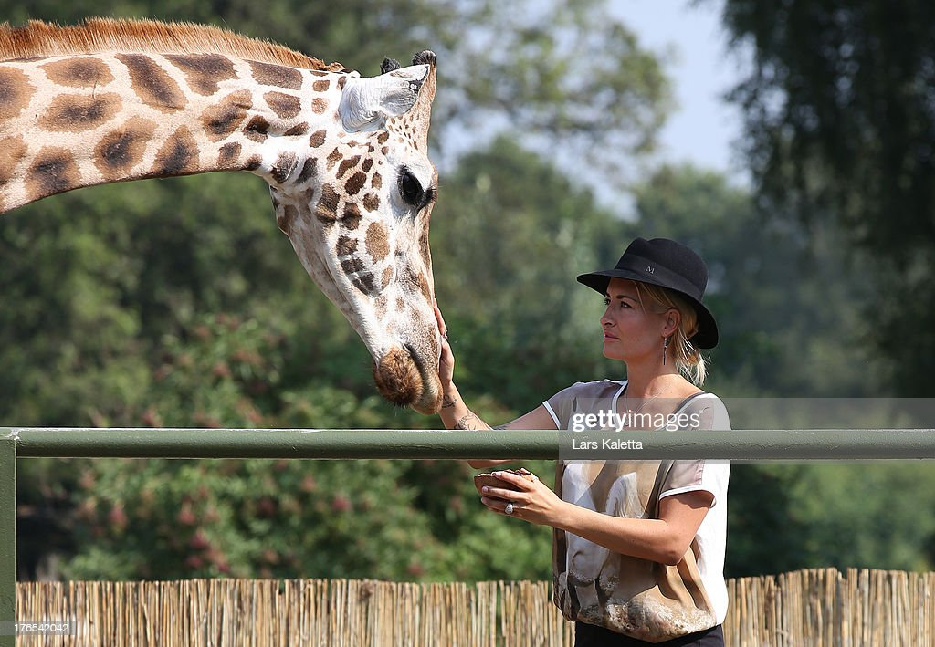 <a gi-track='captionPersonalityLinkClicked' href=/galleries/search?phrase=Sarah+Connor&family=editorial&specificpeople=220670 ng-click='$event.stopPropagation()'>Sarah Connor</a> strokes a giraffe at Serengeti Park on August 15, 2013 in Hodenhagen, Germany.