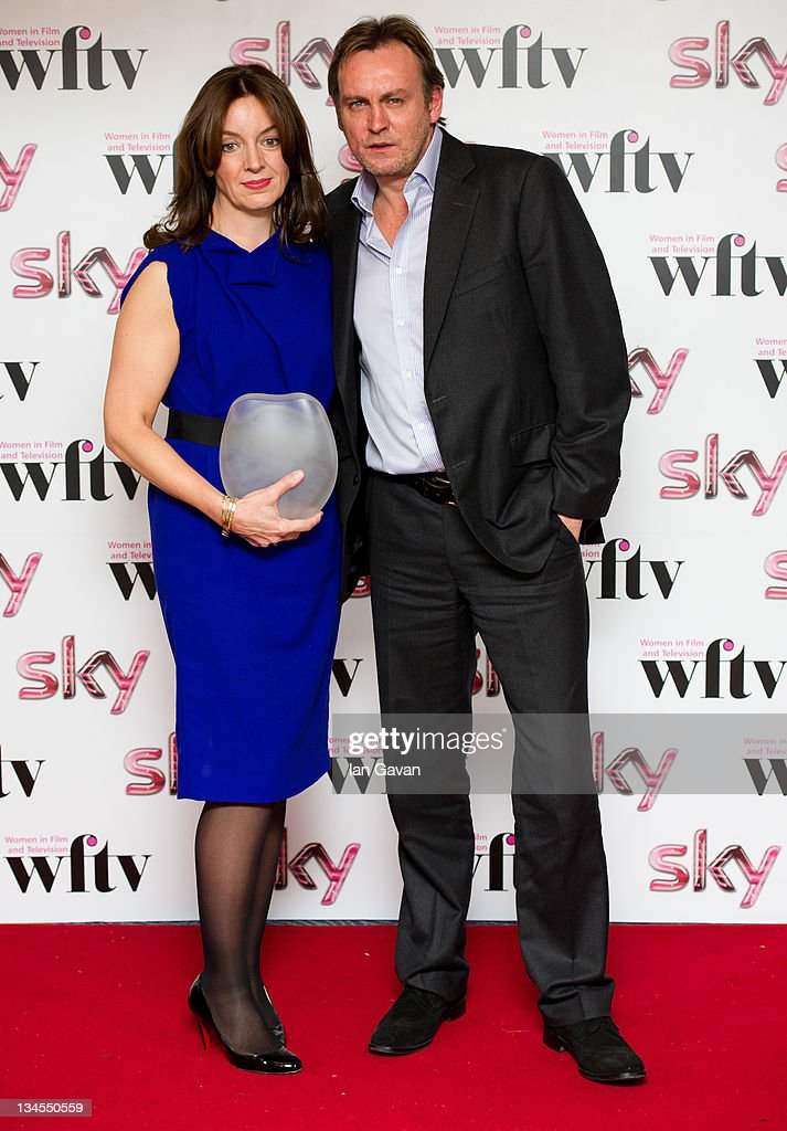 Sarah Cooper poses with her 'Barclays Corporate Business Award' with presenter <a gi-track='captionPersonalityLinkClicked' href=/galleries/search?phrase=Philip+Glenister&family=editorial&specificpeople=714565 ng-click='$event.stopPropagation()'>Philip Glenister</a> during the Women In Film And TV Awards 2011 annual ceremony celebrating the accomplishments of women working in the film and television industries at the Hilton Park Lane on December 2, 2011 in London, England.