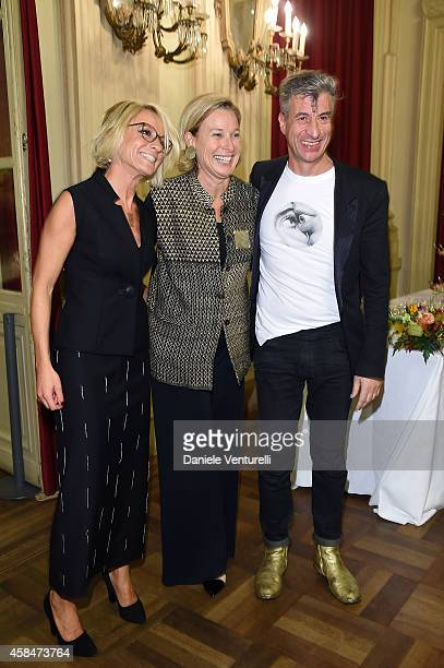 Sarah Cosulich Canarutto Giovanna Melandri and artist Maurizio Cattelan attend 'SHIT AND DIE' Vernissage at palazzo Cavour on November 5 2014 in...